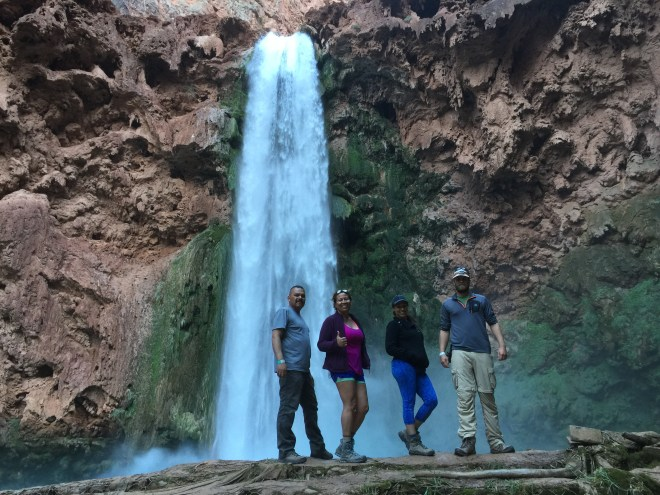 A few brave souls at the bottom of Mooney Falls