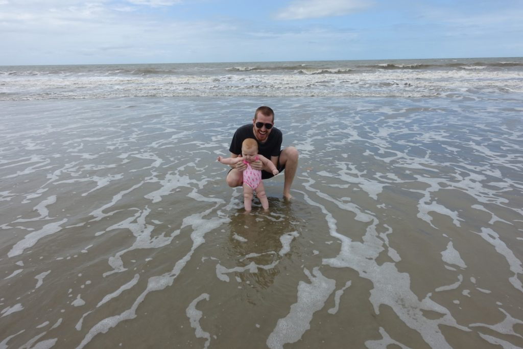 Annabelle and Dad dip toes in the ocean