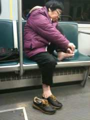 lady clipping toenails subway