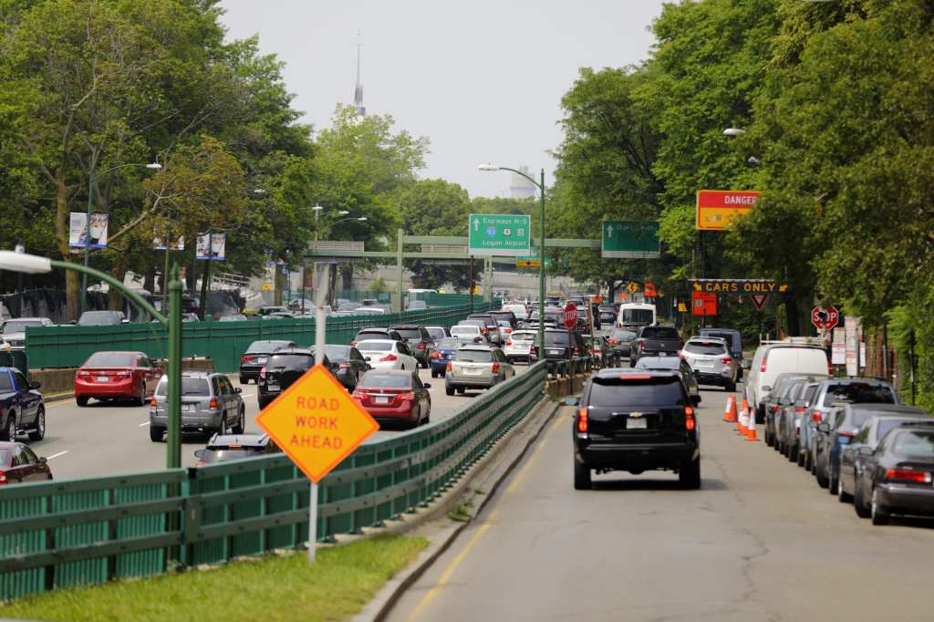 Cars on the highway that is Storrow Drive. You see signs that say DANGER! CARS ONLY!