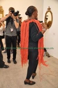 model with orange fringe at Imitation of Christ fashion show