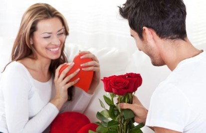 couple with gifts hearts and flowers
