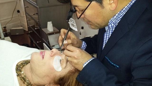 christian Zamora applying lashes to Alison Blackmansmall