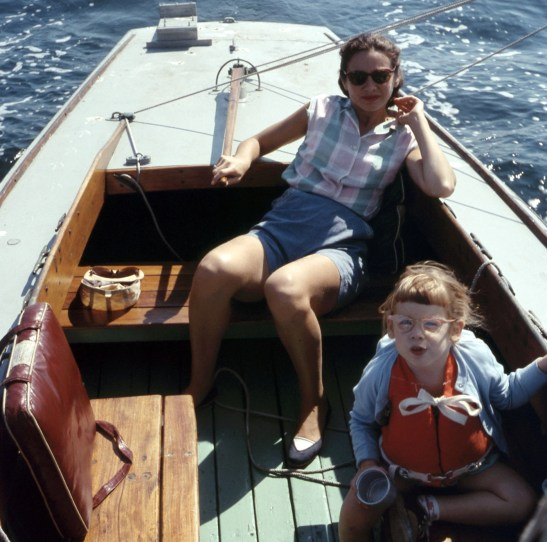 cute kid and attractive mom on a sailboat