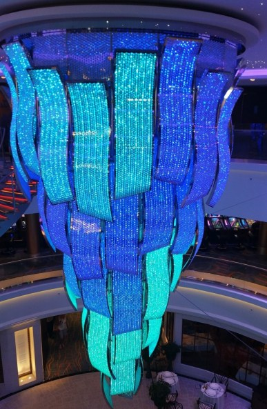 The massive crystal chandelier which is the certerpiece of the Escape's Atrium changes color