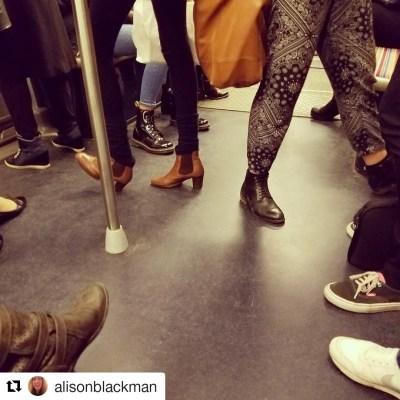 feet on the Paris Metro