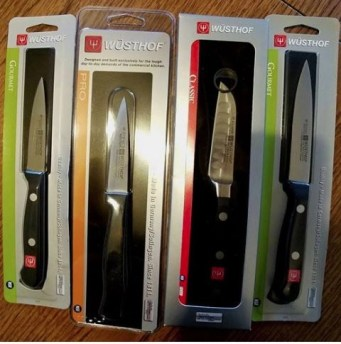 four wusthof knives in a row