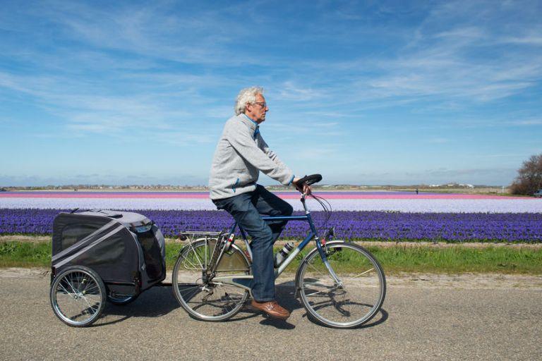 old man riding a bike