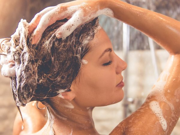 girl applying shampoo