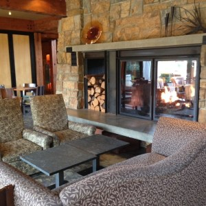 The fireplace in the lobby at Willows Lodge