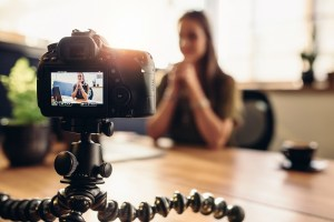 A woman makes a video blog to build an audience
