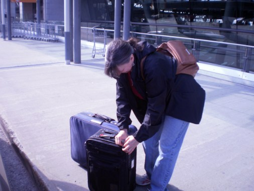 At The Airport- Cathi checking her bags.