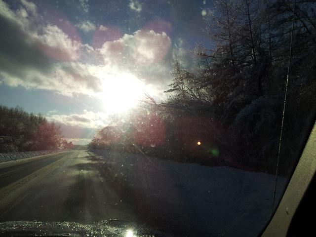 Near prismatic sunburst through jeep window on Bridge Street.