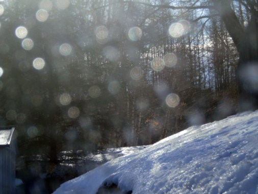 Spotty windshield Snowy Hill in bright sunlight