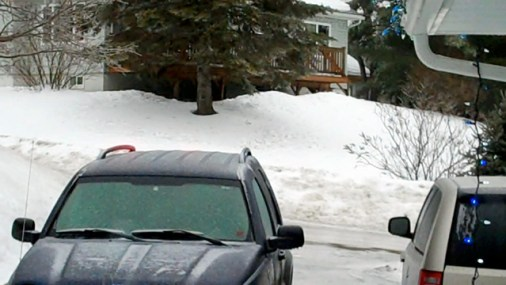 Ice Covered Jeep, driveway, road.