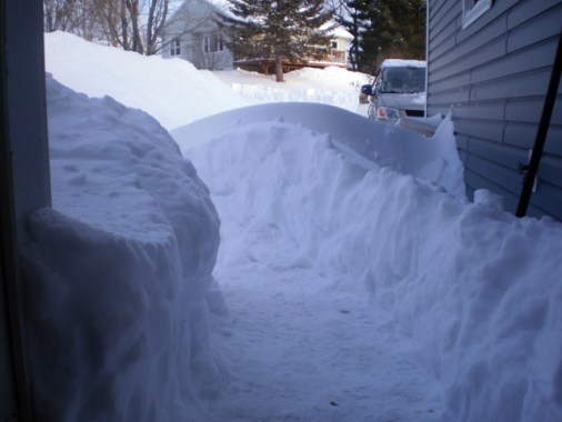 Lots of snow with a path cut through it.