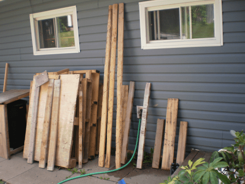 Pallet wood leaning against a house
