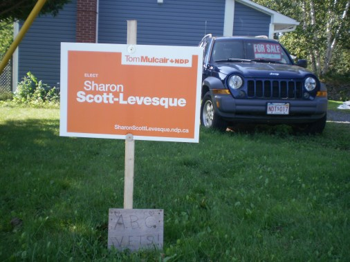 Orange Sign on the lawn.
