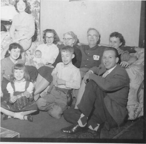 Large Family grouped around a sofa in 1956.