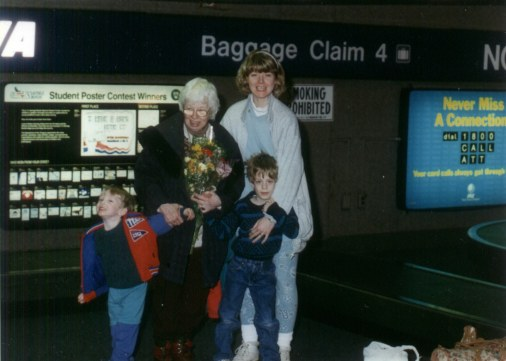 Grandma, two young boys and Nancy in an airport.