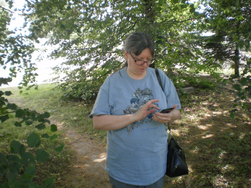 Cathi looking at her cell phone.