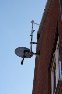 Sattellite dish, log periodic aerial and half wave radio dipole