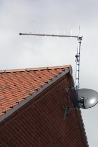 Satellite dish , log periodic aerial and half wave dipole