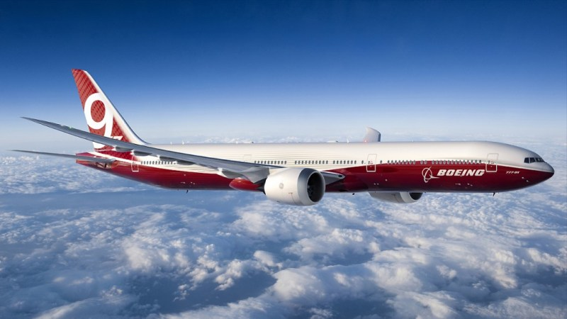 777-9X Flying in Sunlight Over Clouds - 2014