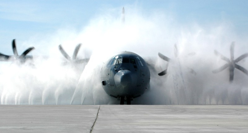 A C-130J Hercules is cleaned up in the new wash system at Keesler Air Force Base, Miss. Aircraft from the Air Force Reserve Command's 403rd Wing fly many hours over the Gulf of Mexico. Salt and moisture could lead to corrosion if aircraft are not kept clean. The new wash blasts aircraft with 2,000 gallons of water per minute, emitting 150 pounds of pressure from each of its 40 nozzles. (U.S. Air Force photo/Tech Sgt. Jame Pritchett)