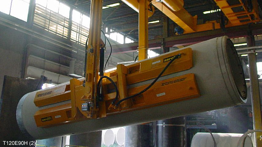 Vacuum turner of Aerolift which is being used to turn a just demoulded concrete pipe 90 degrees