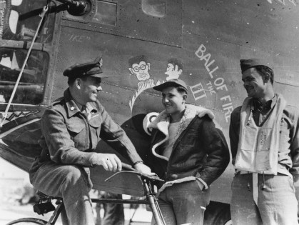 "© Roger Freeman Collection / http://www.americanairmuseum.com - Three airmen of the 93rd Bomb Group stand with the nose art of a B-24 Liberator (serial number 42-40128) nicknamed ""Ball of Fire the III"" - 93rd Bomb Group Museum"
