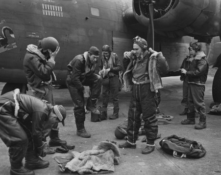 """© Roger Freeman Collection / http://www.americanairmuseum.com - A bomber crew of the 93rd Bomb Group don their flight gear before a mission, flying a B-24 Liberator (41-23717) nicknamed """"Exterminator"""". 3 April 1943 - 93rd Bomb Group Museum"""
