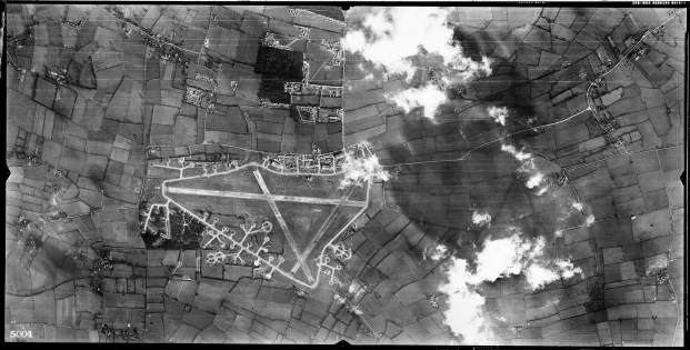 © Roger Freeman Collection / http://www.americanairmuseum.com - Aerial photograph of Hardwick airfield looking east, the main runway runs horizontally, with the technical site immediately above, the bomb dump is lower left, 2 March 1944 - 93rd Bomb Group Museum