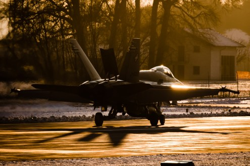 © Adam Duffield - A F/A-18C Hornet taxing after landing in the last light of the day - World Economic Forum Air Policing