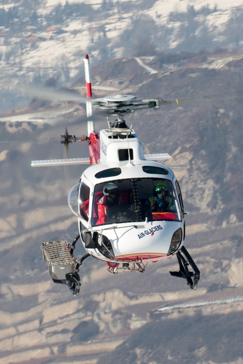 © Adam Duffield - Eurocopter AS 350 HB-XQJ operated by Air Glaciers departs from its base at Sion - World Economic Forum Air Policing