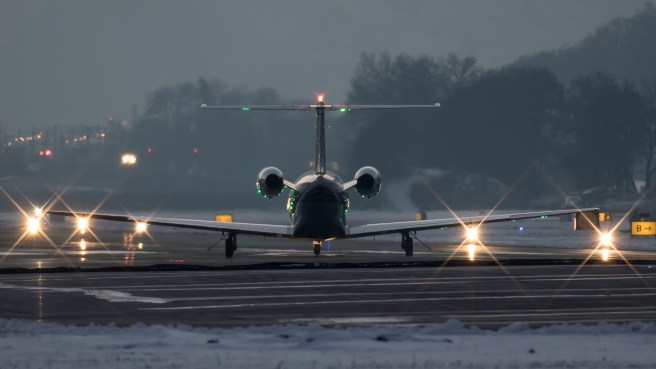 © Adam Duffield - Cessna 525A Citation M-PMCN lines up to depart from Sion, one of many private jets that use the airport - World Economic Forum Air Policing
