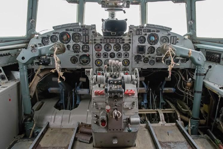 © Duncan Monk - IL-18V 3X-GGU Cockpit - Jurmala Airport Air Zoo