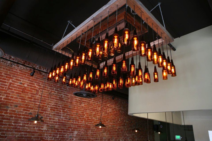 Beer bottle light fixture (Source: https://s-media-cache-ak0.pinimg.com/736x/18/7d/c9/187dc9725f0665de2400cf2b02a54c71.jpg)
