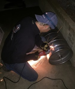 Cutting off the top of the Keg (photo cred. to Roshan Mishra)