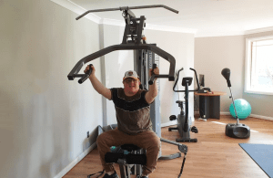 One of our residents using a piece of gym equipment