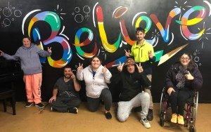 Lurnea clients with their new believe sign