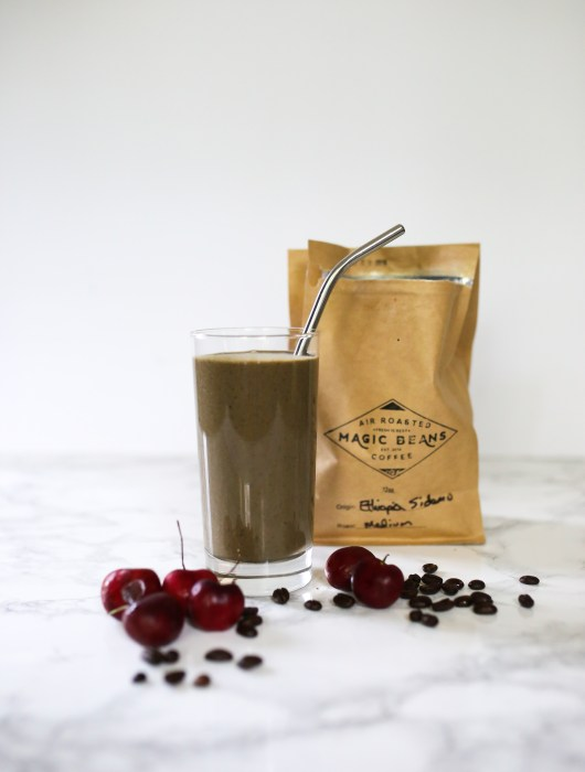 mocha cherry smoothie with coffee beans.