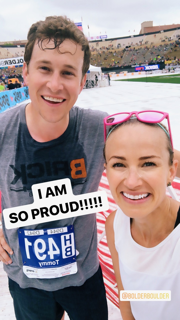 two runners at bolderboulder race finish line