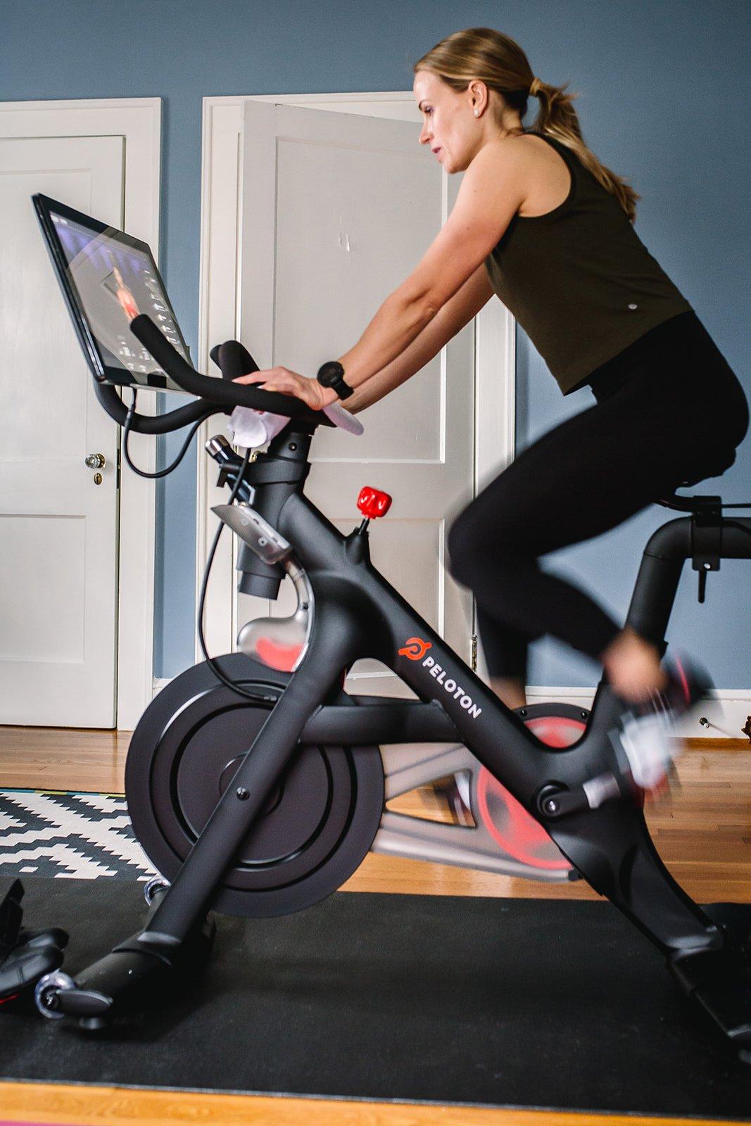 girl riding a peloton bike