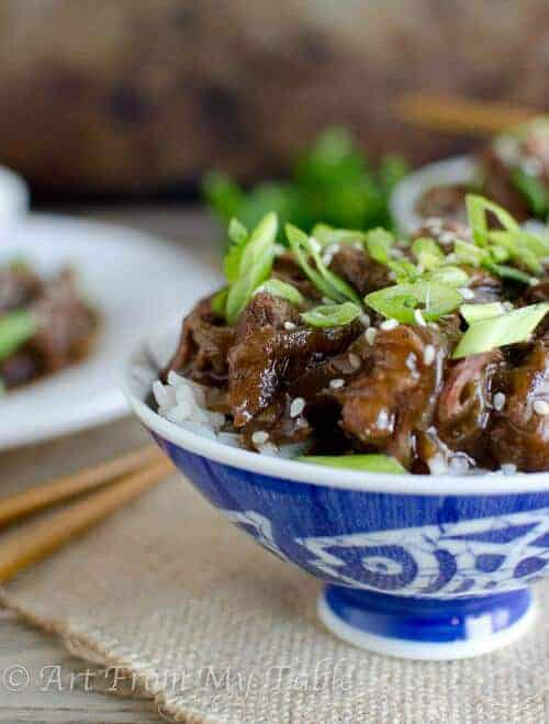 Slow Cooker Mongolian Beef- succulent, tender pieces of beef melt in your mouth. Enjoy take out without leaving the house!