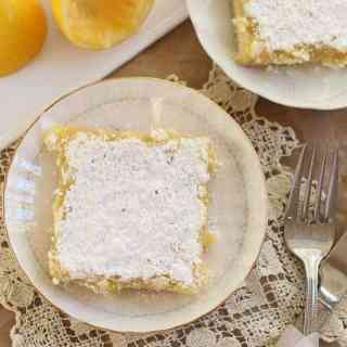 This is the Best Lemon Bars Recipe. The crust is crunchy and buttery. The center is rich, tart, sweet, and gooey. A light, sugary crackle top seals it together. One bite of these lemon bars is a bit of heaven in your mouth. This is one dessert you will want to make homemade!