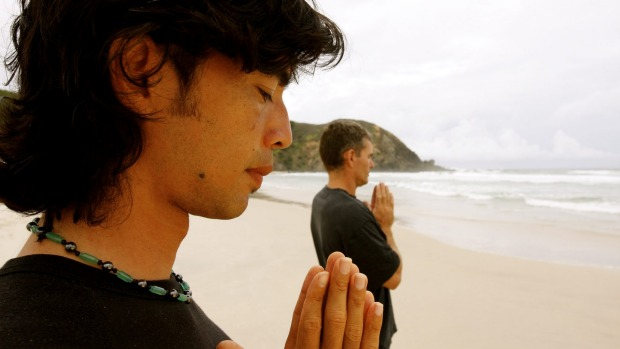 The Sanctuary's Consta Georgoussis (at front) meditates with a client.