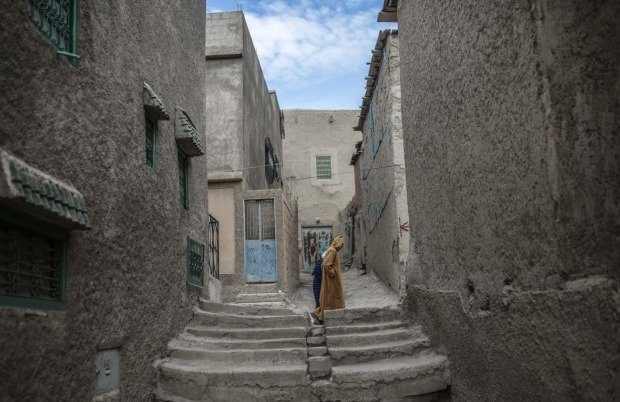A couple walk home after Friday prayers in the Amazigh town of Tounfit in central Morocco.