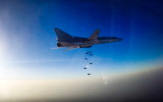 A Russian long range bomber flies during an air strike over Aleppo. The region is a battleground for the major nations.