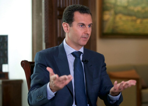 In this Wednesday, Sept. Meanwhile Syrian President Bashar Assad denies that his people are suffering in rebel areas ...